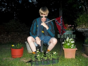 This undated image that appeared on Lastrhodesian.com, a website being investigated by the FBI in connection with Charleston, S.C., shooting suspect Dylann Roof, shows Roof posing for a photo while holding a Confederate flag. The website surfaced online Saturday, June 20, 2015, and also contained a hate-filled 2,500-word essay that talks about white supremacy and concludes by saying the author alone will need to take action. (Lastrhodesian.com via AP) MANDATORY CREDIT