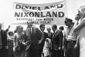 Richard M. Nixon, candidate for the Republican presidential nomination, is seen arriving at the airport in Atlanta, Ga. with his wife, Patricia, on May 31, 1968. A crowd of about 350 people greeted them as Nixon visits the South to meet with delegates from various states. (AP Photo)